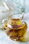 Homemade softening bath oil with dried rose petals