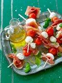 Tomato mozzarella skewers with ham