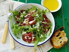 Bresaola with rocket and pine nuts