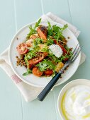 Salsiccia with red lentils and rocket