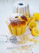 A mini lemon Bundt cake with flaked almonds