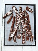 Strips of chocolate cake sprinkled with sugar nibs