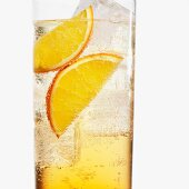 A glass of Aperol with orange slices and ice cubes