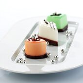 Three different petit fours with silver pearls