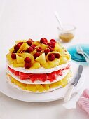 An ice cream cake with meringue and mango and raspberry sorbet