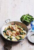 Gnocchi with chicken legs, spinach, ham and Gorgonzola