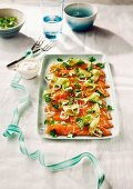 Salmon carpaccio with a courgette salad