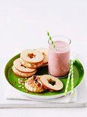 A strawberry milkshake and an apple sandwich
