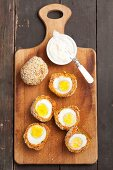 Hard-boiled eggs with a carrot and sesame seed coating
