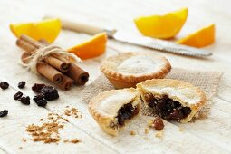 Mince pies, orange slices, cinnamon and dried fruits