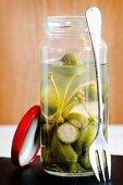 Pickled giant capers in a jar