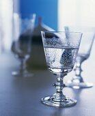 Elegant crystal glasses with a floral engraved pattern