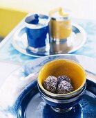 Truffle pralines in ceramic bowls