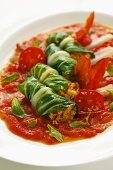 Chard stuffed with couscous in a tomato ragout