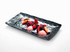 Chocolate desert with fresh berries and strawberry ice cream
