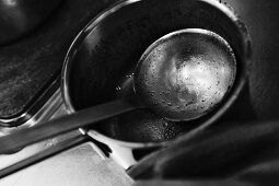 A dirty saucepan and a ladle