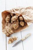 Jerusalem artichokes in a brown paper bag