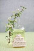 Diluted woodruff syrup and a wedding cake-shaped biscuit