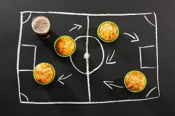 Savoury muffins and cola for a football-themed party