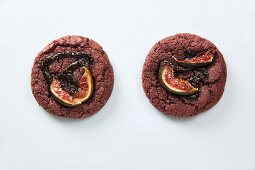 Two chocolate cookies with figs