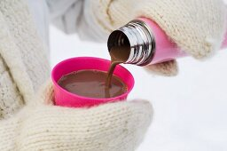 Hhot chocolate being poured into a cup