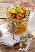 Courgette relish in a jar on a napkin