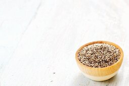 Chia seeds (salvia hispanica) in a wooden bowl