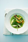 Vegetable stew with carrots, peas, asparagus and mange tout