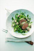 Poached fillet of veal in a herb coating with a creamy morel mushroom sauce and green pasta