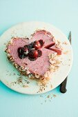 A heart-shaped cherry ice cream cake
