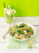 Broccoli salad with egg, blue cheese, sunflower sprouts and walnuts