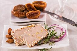 Goose liver pâté with almonds and figs