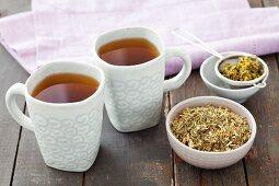 Goat's rue tea and dried tea leaves