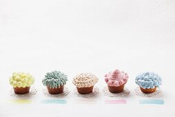 Cupcakes decorated with pastel-coloured cream
