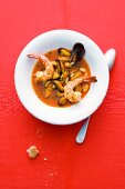 Mussels in a pepper and saffron broth with fried king prawns