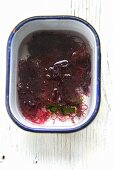 A bowl of red seaweed with water
