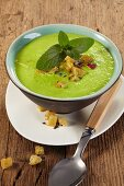 Pea soup with croutons and mint