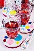 Drinks with straws on felt coasters decorated with colourful felt circles