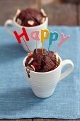 A chocolate muffin with raspberries and almonds baked in espresso cups
