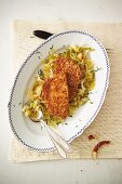 Leberkäse escalope (beef and pork escalope) with a pretzel coating on a bed of Bavarian-style white cabbage