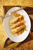 Asparagus wrapped in turkey escalope with fried potatoes