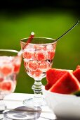 A refreshing drink with watermelon balls