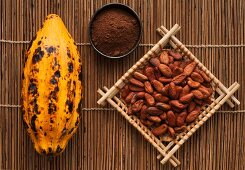 A cocoa pod, cocoa powder and cacao beans