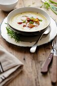 Leek and potato soup with chorizo and spring onions