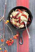 Spaghetti with salmon and chilli peppers