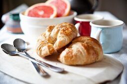 Breakfast with croissants, coffee and grapefruit