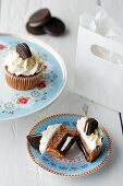 Cupcakes with chocolate biscuits and cream