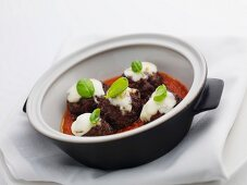 Meat balls with mozzarella in tomato sauce