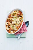 Gratinated tortellini with mushrooms, sweetcorn and tomato sauce