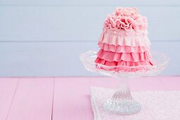 A mini cake with pink icing